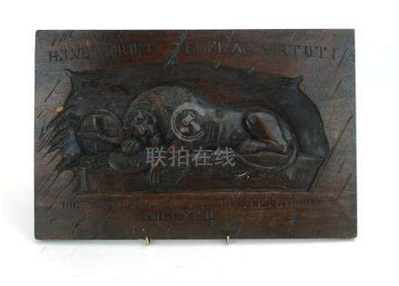 An early 20th century oak plaque relief carved as the Lion of Lucerne,