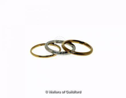 Two 22ct gold wedding bands, weight together 4.4 grams, ring sizes M and M½, together with a white