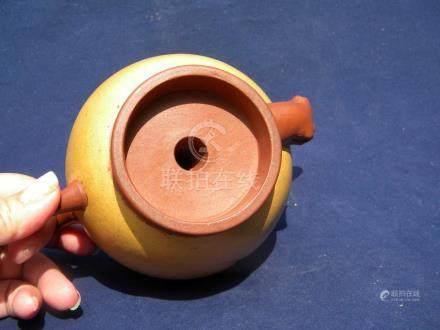 A Chinese Yixing Zisha Peach Teapot, Qing Dynasty
