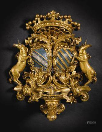 A set of six Italian painted and parcel-silvered carved giltwood wall appliques, circa 1705, Piedmont