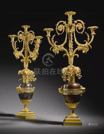 A pair of Louis XVI gilt and patinated bronze four-light candelabra, circa 1780-85, attributed to François Rémond, probably supplied by Dominique Daguerre