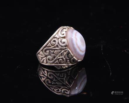 A DZI BEAD AND SILVER THUMB RING
