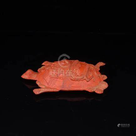 A ZHUSHA CARVED TURTLE SHAPED PENDANT