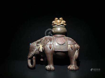 A ZISHA ELEPHANT SHAPED FIGURE