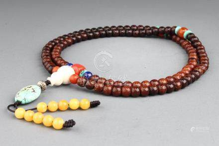 A BEADS STRING BUDDHIST NECKLACE