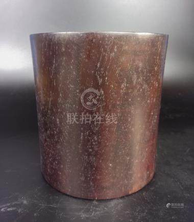 A RED WOOD CARVED BRUSH POT