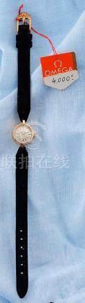 OMEGA VERS 1960 MONTRE DE DAME en or jaune 750 millièmes à mouvement mécanique. Boîtier rond