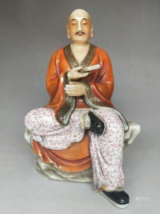 A Famille Rose Porcelain Buddha
