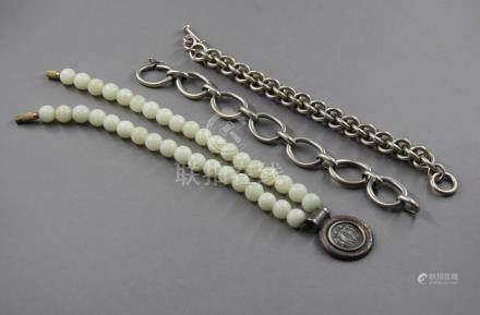 Lot en argent 950 °/°° : - Deux bracelets, pds : 65-46 g. - Collier à boulles de pierres bla