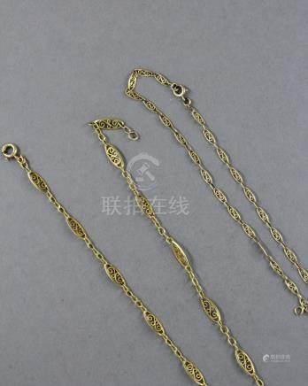 Collier en or jaune 18k à maillons ovales filigranés. L : 38 cm., pds : 7,7 g. Chaine de cou