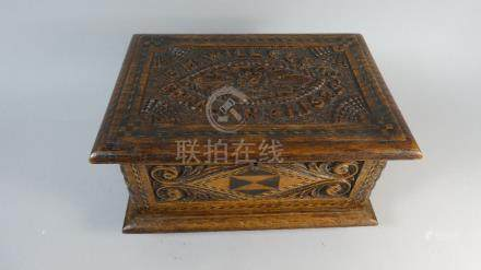 A Carved and Inlaid Oak Work Box, the Hinged Lid Inscribed E M Willcocks, Born Jan 31, 1925.
