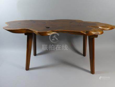 A 19th Century Made Oak and Elm Stool with a Plank Top Supported on Shaped Trestle Ends,