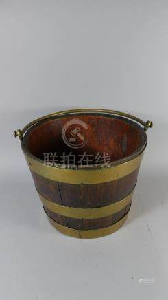 A 19th Century Brass Banded Mahogany Bucket of Coopered Construction with Brass Loop Handle,
