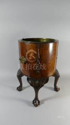 A Nice Quality Burr Walnut Circular Wine Cooler with Moulded Decoration and Brass Drop Handles.