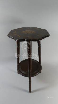 A Late 19th Century Mahogany Cricket Table with a Shaped Top.