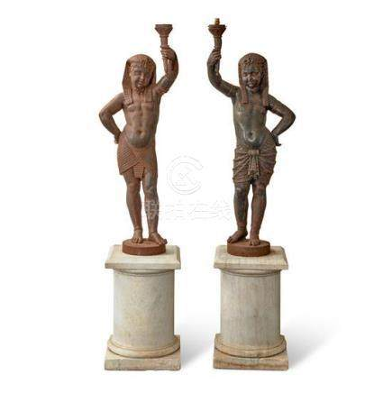 A pair of cast iron Egyptianate figural torchères, French, l