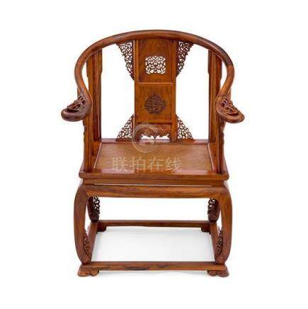 A huanghuali and hardwood Qing-style horseshoe-back armchair