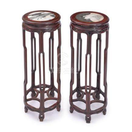 A pair of hardwood 'dreamstone' marble-inset incense stands,