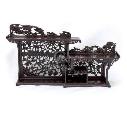 A carved wood wall display stand 68 cm high, 110 cm wide, 16