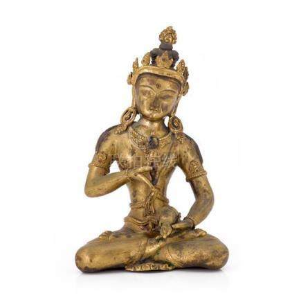 A gilt bronze figure of Vajrasattva 24 cm high