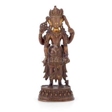 A parcel-gilt bronze figure of Vishnu, Nepal circa 16th cent