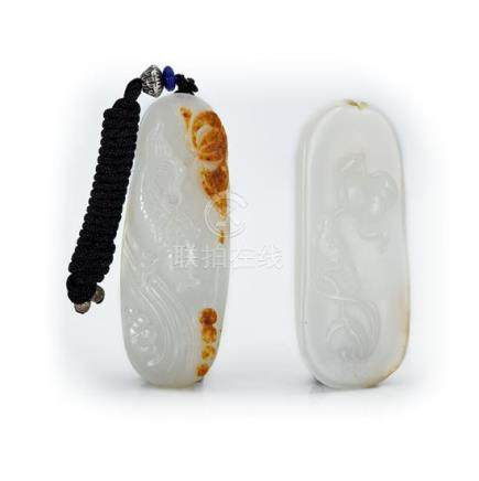Two oval white jade pendants (2) 6.5 cm, 6.7 cm long