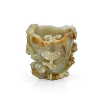 A celadon and russet jade 'lingzhi' washer Xi Qing dynasty,