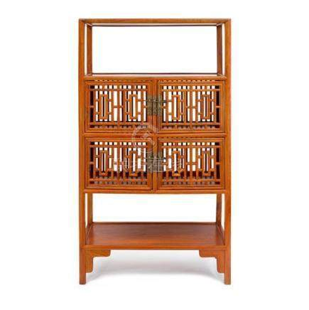 A Ming-style huanghuali open shelf cabinet with spindles and