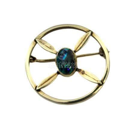 Natural black opal cabochon 14 k. yellow gold brooch