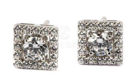 Square shaped stud earrings in silver and cubic zirconias