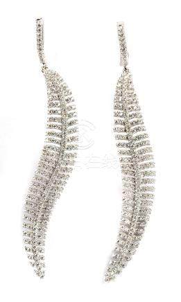 Feather shaped silver and cubic zirconias earrings