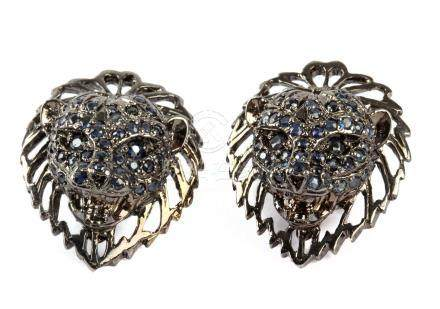 Lion head shaped earrings in black rhodium plated silver and shapphires
