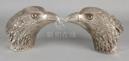 Two old Chinese metal eagle heads with bottom marks.