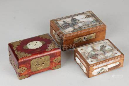 Three old Chinese lid boxes. 20th century. Two boxes