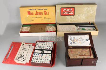 Four Chinese mahjong play in holders. 20th century.