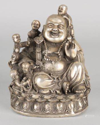 Old Chinese white metal buddha statue with floor mark.