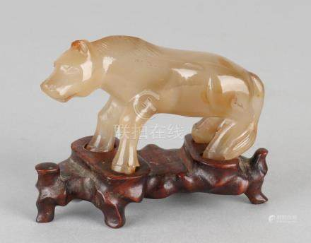 Chinese agate figure. Feline on wooden basement. First