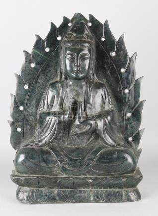 Large antique Chinese jade buddha on lotus flower.