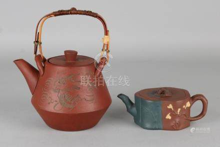 Two old Chinese Yixing teapots. Marked. 20th century.