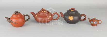 Four old Chinese Yixing teapots with various floral