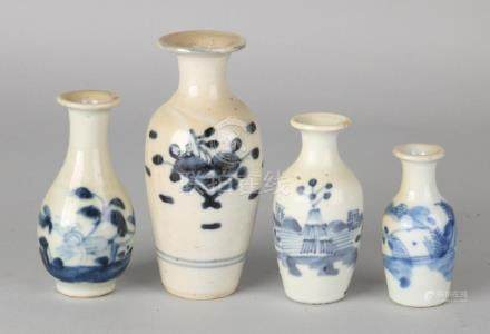 Four antique Chinese porcelain vases with various blue