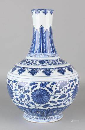Old blue Chinese porcelain vase with floral decor. Soil