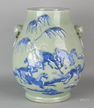 Large old Chinese porcelain celadon vase with blue