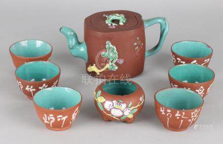 Antique Chinese Yixing teapot with six bowls, partly
