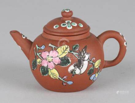 Small old Chinese Yixing teapot with blossoms and bird