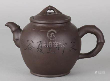 Old Chinese Yixing teapot with bamboo decor and soil