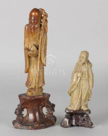 Two antique natural stone Chinese figures. First half
