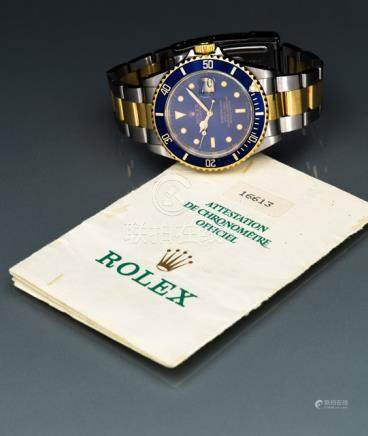 Rolex Submariner, Ref. 16613. Automatic movement; hour, minute, second, date; blue dial with golden