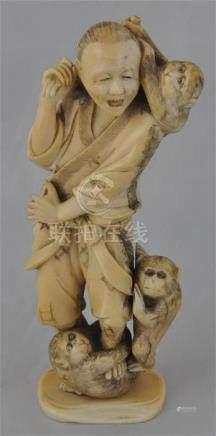 A Japanese Meiji period carved marine ivory okimono, of a man andmonkeys, (some damage), height