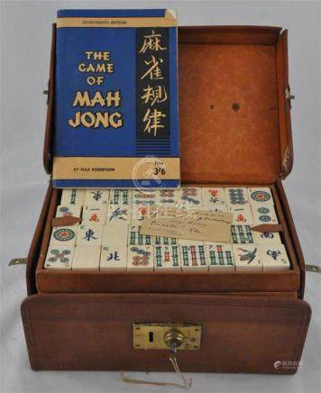 A Chinese bone and bamboo Mahjong set in hide case, each block decorated in colours with various
